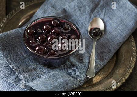 Fancy Dark Maraschino Cocktail Cherries in a Bowl - Stock Photo