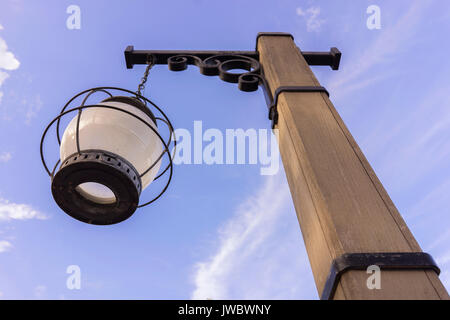 Rustic style wood street light on a prairie in colorado there is a wooden light post vintage old west and rusty stock photo aloadofball Images