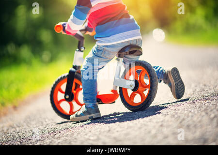 children on a bicycles - Stock Photo