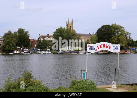 Bell Inn, St Mary's Church and Ferry at Hampton, seen across River Thames from Molesey, Surrey, England, Great Britain, - Stock Photo