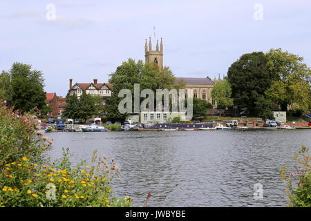 St Mary's Church at Hampton, seen across River Thames from East Molesey, Surrey, England, Great Britain, United - Stock Photo