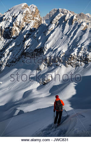 A mountaineer stand ready to ski downhill at 2490 meters at Forca Rossa. - Stock Photo