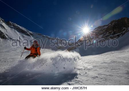 Skiing downhill near Marmolada. - Stock Photo