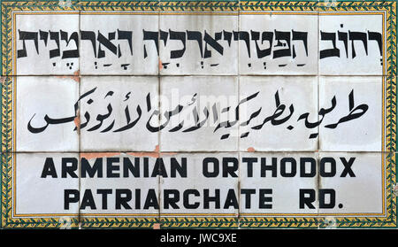 Sign on ceramic tiles in English Hebrew and Arabic of the Armenian Patriarchate road at the Armenian Quarter in - Stock Photo