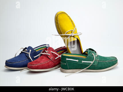 Colored shoes on white ground - Stock Photo