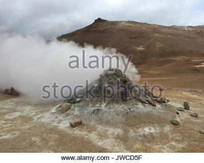 Steaming vents,craters,fissures and lava floes near Krafla volcano,a geothermal area at the northern side of the - Stock Photo