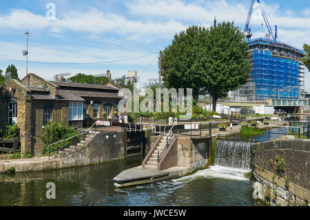 St Pancras Lock on the Regents Canal, at King's Cross, London UK, with new apartments under construction in background - Stock Photo