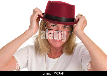 Attractive middle-aged woman with glasses and a hat - Stock Photo