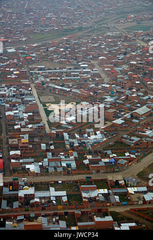 Brick buildings of El Alto (4150m/13,615ft), La Paz, Bolivia, South America - aerial - Stock Photo