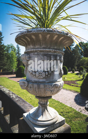 ... Decorative Stone Planter Urn In A Large Garden   Stock Photo