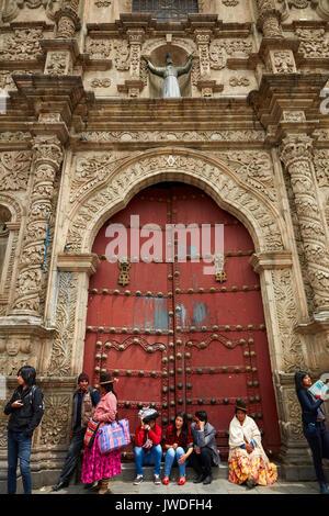 Bolivians and the front door of the Basilica of San Francisco, Plaza Mayor, La Paz, Bolivia, South America - Stock Photo
