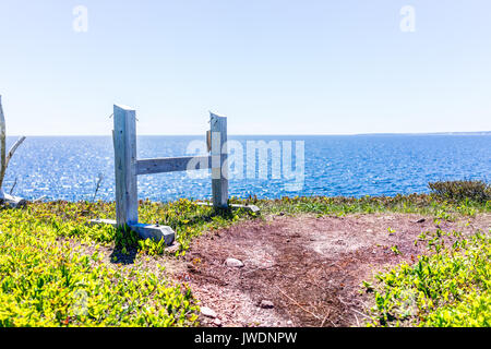 Trail hiking in Bonaventure island by Perce, Quebec in Gaspe, Gaspesie region with wooden fence on edge of cliff - Stock Photo