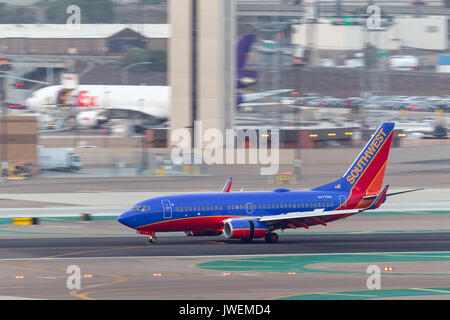 Southwest Airlines Boeing 737-7H4 N477WN arriving at San Diego International Airport. - Stock Photo