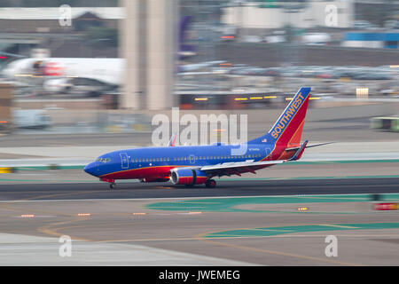 Southwest Airlines Boeing 737-7H4 N734SA arriving at San Diego International Airport. - Stock Photo