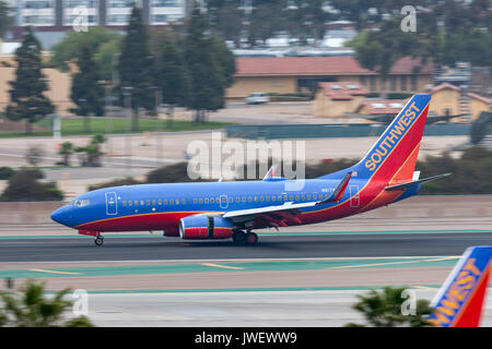 Southwest Airlines Boeing 737-7H4 N917WN arriving at San Diego International Airport. - Stock Photo