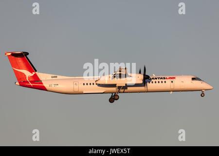 QantasLink de Havilland Canada DHC-8-402Q (Dash 8 Q400) VH-QOR on approach to land at Melbourne International Airport. - Stock Photo