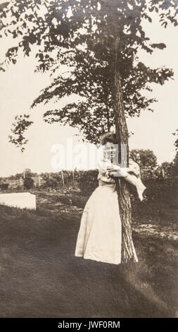 A Tree Hugger in MInnesota USA 1907-1908 having fun - Stock Photo