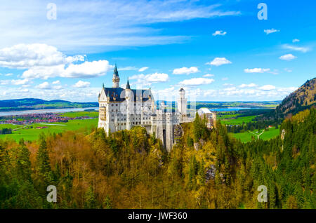 view of the famous tourist attraction in the Bavarian Alps - the 19th century Neuschwanstein castle. - Stock Photo