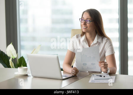 Smiling businesswoman satisfied with fast growing startup, risin - Stock Photo