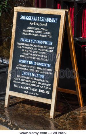 Smugglers Restaurant A Board advertising the menu, Ilfracombe, Devon, England - Stock Photo