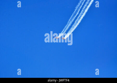 Red airplanes on the blue sky backgorund during airshow in Gdynia, Poland - Stock Photo