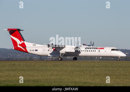 QantasLink (Qantas) deHavilland DHC-8 (Dash 8) twin engined regional airliner aircraft at Sydney Airport. - Stock Photo