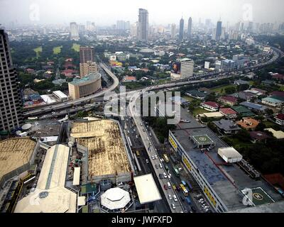 METRO MANILA, PHILIPPINES - AUGUST 8, 2017: Commercial and residential buildings and structures in the cities of - Stock Photo