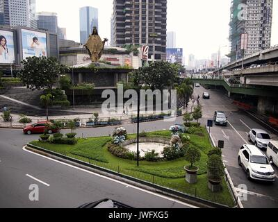 QUEZON CITY, PHILIPPINES - AUGUST 8, 2017: Vehicles pass by the Edsa Shrine. - Stock Photo
