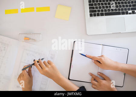 Top view Creative architect projecting on blue print. - Stock Photo