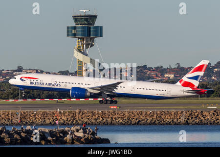 British Airways Boeing 777-300 aircraft taking off from Sydney Airport. - Stock Photo