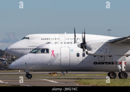 QantasLink Dehavilland DHC-8 (Dash 8) twin engined regional airliner at Sydney Airport. - Stock Photo