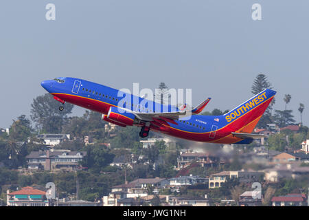 Southwest Airlines Boeing 737-7H4 N720WN departing San Diego International Airport. - Stock Photo