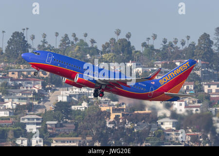 Southwest Airlines Boeing 737-7BD N7732A departing San Diego International Airport. - Stock Photo
