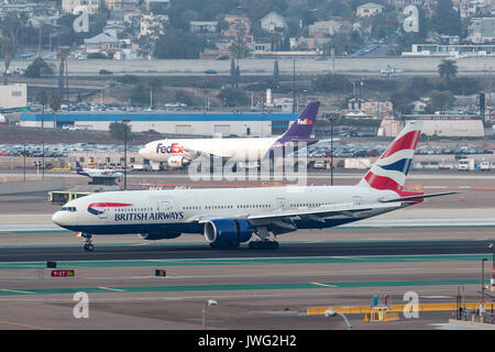 British Airways Boeing 777-236/ER G-YMMU arriving at San Diego International Airport. - Stock Photo