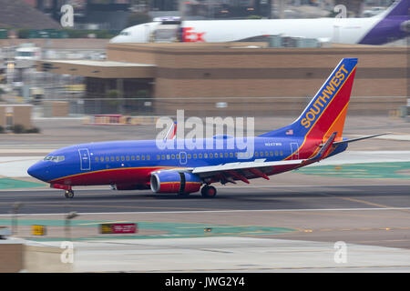 Southwest Airlines Boeing 737-7H4 N247WN arriving at San Diego International Airport. - Stock Photo
