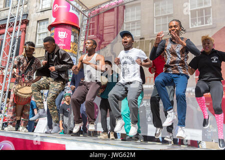 Capella Gang Show singers and dancers performing on the Royal Mile at The Edinburgh Festival Fringe - Stock Photo