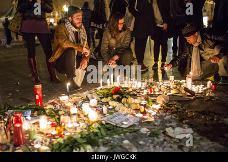 People mourning. Homage at the victims of Charlie hebdo killing in Paris the 7th of january 2015. - Stock Photo