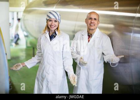 Farm employees working in raw milk sector of livestock farm