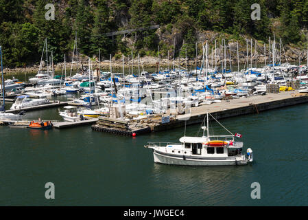 A Marina With Private Yachts ,Cabin Cruisers and Luxury Boats at Horseshoe Bay near BC Ferries Ferry Terminal in - Stock Photo