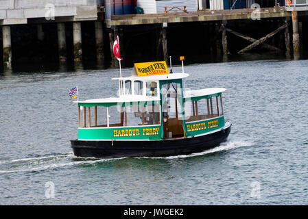 The Small Upright Harbour Ferry Cruising in the Inner Harbour in Victoria Vancouver Island British Columbia Canada - Stock Photo