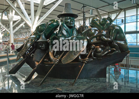 The Spirit of Haida Gwaii: The Jade Canoe, bronze sculpture by Haida artist Bill Reid, Vancouver International Airport, - Stock Photo
