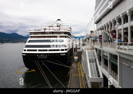 The Holland America Line Cruise Ship MS Volendam Docked at The Port of Vancouver Alongside The Terminal Building - Stock Photo