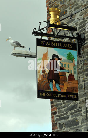 the old custom house public house owned by st Austell brewery in Padstow on the north Cornish coast. seagull sitting - Stock Photo