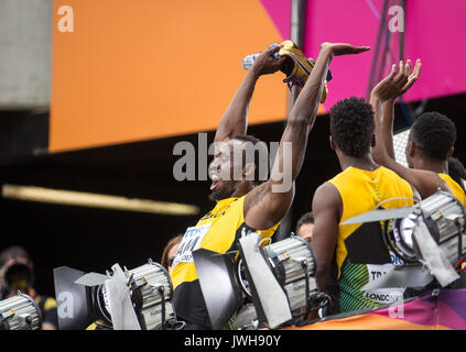 London, UK. 12th Aug, 2017. Usain BOLT of Jamaica joins in with the crowd on a Mexican wave after his 4x100m relay - Stock Photo