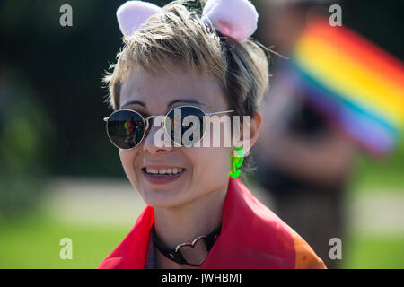 St. Petersburg, Russia. 12th Aug, 2017. People attending a rally are reflected on a participant's sunglasses during - Stock Photo