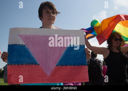 St. Petersburg, Russia. 12th Aug, 2017. A participant is seen during the Gay Pride demonstration in Field of Mars. - Stock Photo