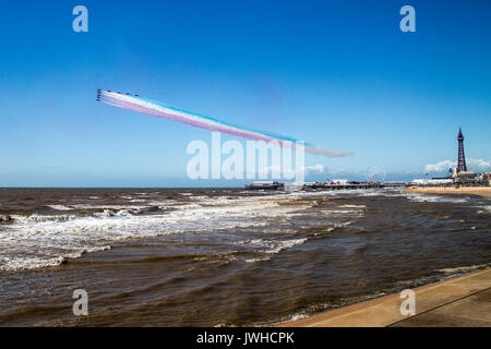 Blackpool, Lancashire, UK. 12th Aug, 2017. RAF Red Arrows finishing their display at Blackpool and departing. Credit: - Stock Photo