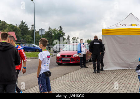 Bielsko-Biala, Poland. 12th Aug, 2017. International automotive trade fairs - MotoShow Bielsko-Biala. People standing - Stock Photo