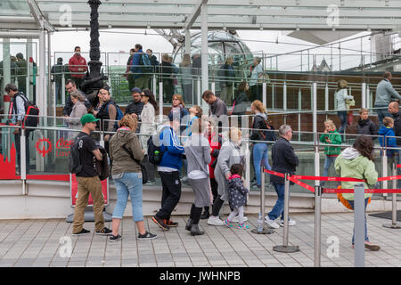 LONDON, ENGLAND - JUNE 08, 2017: Tourists in waiting queue for visiting London Eye in London, England - Stock Photo