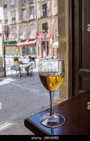 Glass of beer in the interior of a bar - Stock Photo